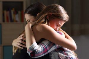 Mother daughter hug